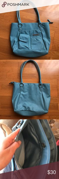 baby blue handbag tote bag purse utility fashion This bag is new and it is such a pretty hue of powder baby boue. it has so many compartments and pockets its great to organize all of your things! Rosetti Bags Shoulder Bags