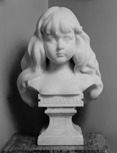 A white carrara marble bust of Princess Elisabeth of Romania when a child, facing the spectator, with long flowing hair; Marble Bust, Young Prince, Princess Elizabeth, The Spectator, Grand Duke, Imperial Russia, Rare Pictures, Hessian, Prince And Princess
