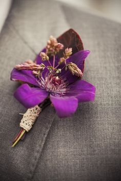 Boutonniere | Purple | Photography: Amanda McKinnon Photography | On SMP: http://www.stylemepretty.com/2013/11/22/malibu-wedding-from-amanda-mckinnon-photography