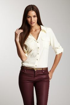 Ivory button up tucked in to pants + a belt.