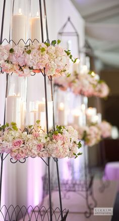 Pillar candles , flowers in French wire towers