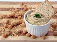 SLEEP AIDES  3. Hummus  This popular spread most often serving as an accompaniment to crackers, pita, and vegetables, can help curb your appetite come night time to prevent waking up in the middle of the might hungry. Hummus contains L-tryptophan — an amino acid that makes you sleepy — and turns to 5-HTP, releasing relaxing serotonin, says Washington State University Alcohol & Drug Counseling, Assessment, & Prevention Services.