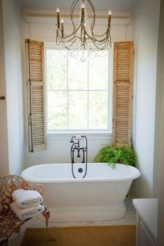 Bathroom Window. I really like these shutters. I wonder if this may work for that crazy window design we have...maybe with salvage shutters?