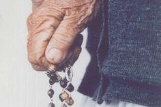 Mother Teresa's hands clutching a rosary. Photo taken by Fr. Charles Woodrich on her visit to Denver in the 1980's.