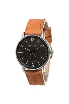 Easy and elegant, this mid-century modern inspired watch is designed with a unique domed dial and slim elongated handset. The line index features alongside numerals at twelve and six, while a smaller sub dial sits below. Features: Battery operated Japanese Miyota quartz movement, tested at 3 ATM water resistance, stainless steel case with IP rose gold plated finish, Italian leather strap, stainless steel case back, crown & buckle, and a mineral glass lens. Designed in San Francisco.     Case…
