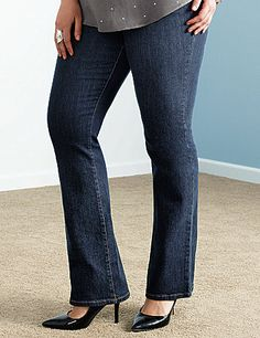 Genius Fit slim bootcut jean with LYCRA dualFX denim stays true to your shape and never stretches out. Bid farewell to sagging and waistband gaps with a curve-hugging fit from morning until night! Dark rinse denim with rivets and classic 5-pocket style. Button and zip fly closure and belt  loops.   LYCRA dualFX denim is a Lane Bryant exclusive! lanebryant.com