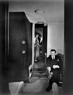 Preparing for the night aboard a Pan Am Boeing B-314 Clipper flying boat, during the early 1940s. Passengers wait briefly, as the seats are turned into cosy bunks, with curtains. #aviationglamourpanam
