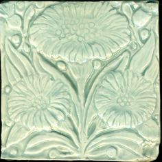 """Floral Tile inspired by a  William De Morgan tile known as """"Bedford Park"""". This relief handmade porcelain tile is 4 x 4 x 1/2"""" . It is handpressed in my handmade mold from my hand carved model. It is hand decorated with a transparent celadon glaze. B.A. Schmidt Arts."""