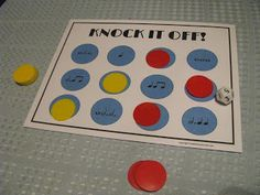 Knock it Off!  The game board is made up of 12 circles with rhythm values totaling from 1 to 12.  Students roll the die and find the circle of rhythm that matches the number on the die and place one of their chips on the circle.