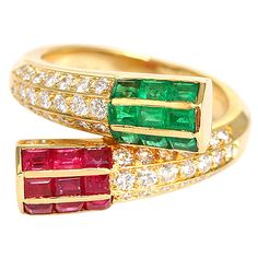 Amazing Designer FRED  PARIS Diamond, Ruby, and Emerald Ring.This ring is superior quality. It is made of 18k yellow gold and features 9 rubies, 9 emeralds, and 42 diamonds.