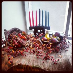 A kinara is displayed for those celebrating Kwanzaa
