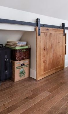 Nothing is worse than heaving your stuff all the way up to the attic, then letting it sit out in plain sight. What's the point? Instead, utilize rolling doors to make it easy to store items out of the way — in style.