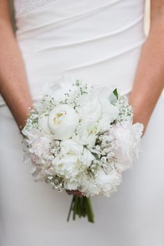 Wedding bouquet - mix of white roses, peonies and gypsophila, with a simple white ribbon.
