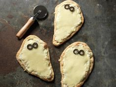 Individual Spooky White Pizzas, perfect for the kiddos and Halloween!