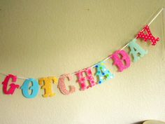 UP TO 14 LETTERS Completely Custom Happy Gotcha Day Fabric Letter Banner. $30.00, via Etsy.