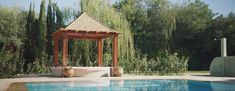 One of the distinguishing features of the property is the=is stunning Pool Hut. Gazebo, The Incredibles, Outdoor Structures, Concept, Architecture, Creative, Design, Arquitetura, Kiosk