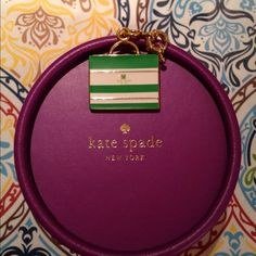 Kate Spade charm Adorable Kate Spade mini handbag charm in green and white stripes.  This can be attached to charm bracelet or key ring.  Comes with Kate Spade box. kate spade Jewelry