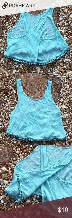 Open Back Swing Crop Top Open Back Swing Crop Top by Forever 21 - Super cute & perfect for showing off your summer tan while trying to stay cool this summer! Pom Pom trim edging. Color: Tiffany Blue. Material: 100% Rayon. Excellent used condition. Size Juniors Large.  Forever 21 Tops Crop Tops
