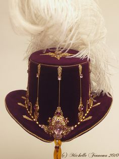 Artemis--Eggplant velvet, gold chain, freshwater pearls, swarovski crystals, brass findings, vintage brooch. Elizabethan tall hat created by Michelle Fennema 2010.