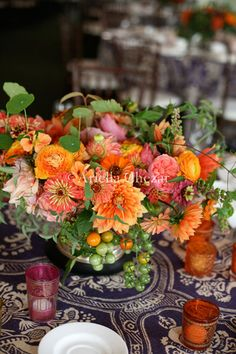 pink, yellow and orange centerpiece with dahlias, garden roses, ranunculus and zinnias | lush, organic flowers | floral design by Ariella Chezar