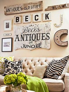 Inspiration Mash Up: 10 Vintage Inspired Gallery Walls - Bless'er House I love the square Scrabble-type letters used to spell out the last name