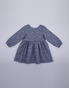A long sleeve top for girls with gathers. The dress is cut from a denim chambray fabric with a small leaf design print. Cotton Made in South Africa Available Sizes: years years years years years years years Chambray Fabric, Small Leaf, Printed Denim, Kids Clothing, 6 Years, Boy Or Girl, Long Sleeve Tops, Kids Outfits, Girls