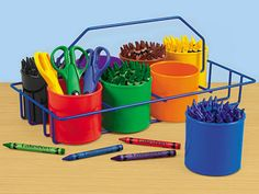 """Classroom Carry-All    There's no better way to organize art centers and craft projects! Lightweight, portable and handy as can be, our convenient carry-all comes with 8 plastic storage cups that are perfect for all kinds of art supplies, from pipe stems and craft sticks to crayons and scissors. The kid-safe metal carry-all measures 7 1/8"""" x 14"""" wide. Supplies not included.  LA416 • $19.95"""