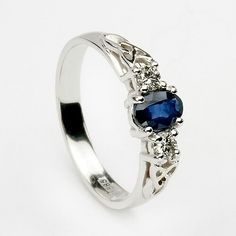 Engagement Rings A stunning engagement ring. even if it wasn´t an engagement ring I loved it! :) - Surprise your loved one with this beautiful sapphire Celtic engagement ring. Set in white gold, the oval shaped sapphire is set between two diamonds. Irish Engagement Rings, Engagement Jewelry, Wedding Jewelry, Solitaire Engagement, Celtic Wedding Rings, Celtic Rings, Celtic Knot, Wedding Bands, Ring Verlobung