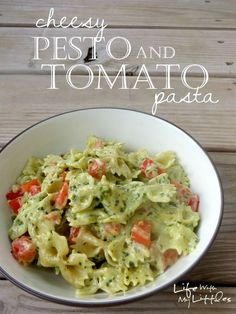 Cheesy Pesto and Tomato Pasta: A creamy, cheesy pasta made with homemade basil pesto and tossed with garden-fresh tomatoes! Perfect for a quick weeknight dinner!