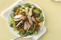 """Try this warm chicken salad with a great """"citrus hit"""" coming from both the dressing and mandarin oranges."""