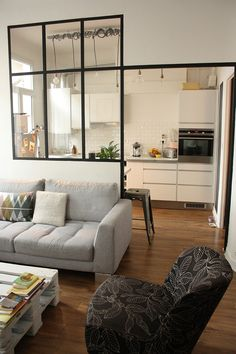 closed but open kitchen concept - glass separation between kitchen and living space