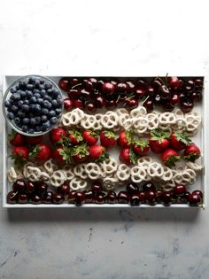 Make an American flag with blueberries, cherries, strawberries, and yogurt-covered pretzels! Very patriotic for the Fourth of July. Get the recipe: http://blog.freshdirect.com/edible-american-flag-platter/