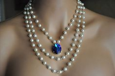 OH MY GOODNESS I NEED THIS TO BE MY SOMETHING BLUE. WOW. THIS NECKLACE. THE BLUE. <3 JOSIE This is an original design by Cynthia Couture Bridal A lifelong treasure Handmade necklace which features a X mm Swarovski Crystal Heliotrope pendant set in a sterling silver plated