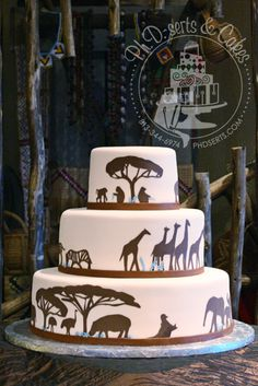 For a wedding at the zoo, the cake was decorated with silhouettes of African animals. By Ph.D.-serts & Cakes.