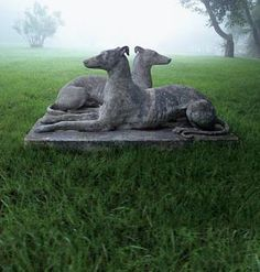 Duo of 19th-century greyhounds from garden antique seller Barbara Israel. Via www.gardendesign.com.