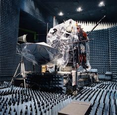 Rosetta, with its main 2.2 m-diameter high-gain antenna deployed, undergoing extensive electromagnetic compatibility (EMC) testing in the Compact Payload Test Range in August 2002.