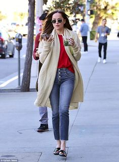 Food on the go: Dakota Johnson grabbed a healthy snack in Los Angeles on Monday