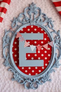 Wall Decor - this is darling! Looks easy to make with a frame, wooden letter, paint, and fabric. {Home Decor Ideas} {DIY Project Idea}