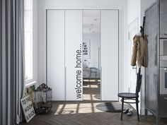 (slaapkamer idee) An artistic mirror sits at the entrance to the apartment with a lovely typographical accent.