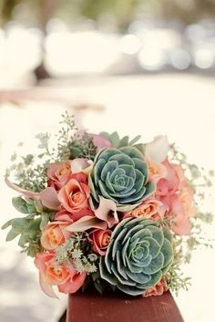 Succulent Bridal Bouquets {Trendy Tuesday} | Confetti Daydreams - Succulent bouquet with pinkish-peach roses perfect for a mint green and peach wedding ♥  ♥  ♥ LIKE US ON FB: www.facebook.com/confettidaydreams ♥  ♥  ♥ #Wedding #Succulents #Bouquets