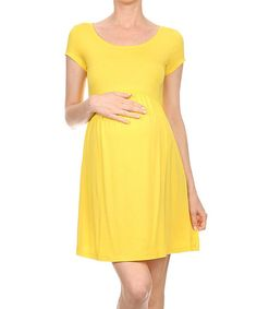 43c5a1faf5132 This Yellow Maternity Empire-Waist Dress by Chris & Carol Maternity is  perfect!