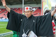A Japan supporter shows off his authentic clothing as he prepares to watch his side take on Scotland
