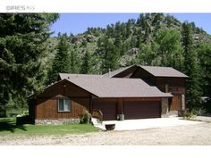 4306 sf 1 1/2 story year around home w/a basement + guest apartment. Location is amazing and private with Poudre river frontage and on 1.5 acre lot. Big 1436 SF shed with plenty of storage with oversized garage door for your RV. The home is highly upgraded with several fireplaces,lots of wood accents, 4 bedrooms, 4 baths in the main house, with a walk-out basement mostly finished that leads you to wonderful views of the river. The guest apartment has a kitchen, bedroom & bath too!