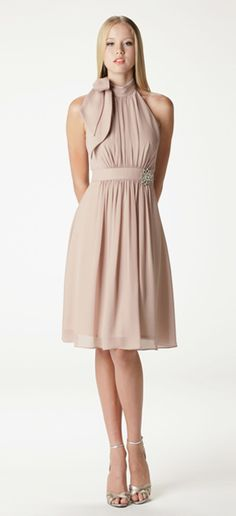 "Gathered halter bridesmaid dress with built in waistband. Waistband hits slightly above the natural waist. Tie closoure on back neck. Shown here as a knee length ""J"" skirt in sahara georgette. Accessorized with our rhinestone brooch (sold separately). Fully lined."