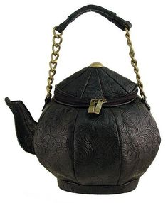 This Is such a unique bag, it's a tea pot!!!!!!!! This bag is black with a black damask pattern. On the top it has the black zippering and gold pulley things. At the tippy top it has a gold metal circle thing. Then it has a gold chain with  a leather thing  where you hold it, you can use as a shoulder bag. If I knew where to get this I would definitely get it.