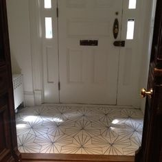 """Dandelion - milk/marine - Collection 2012 - Marrakech Design is.interesting idea to make a graphic tile """"rug"""" at an entrance.more durable than wood Entry Tile, Tiled Hallway, Entryway Flooring, Tile Entryway, Entry Stairs, Front Entrances, Nyc, Entrance Hall, Inspired Homes"""