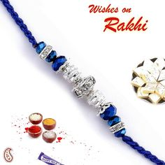 This raksha bandhan strength the bonds of sibling love with this exclusive hand made Rakhi made from Deep Blue Cut Crystal Beads and silver American diamonds hoops. The Rakhi comes with Shagun Elements, Sweets and Chocolate .