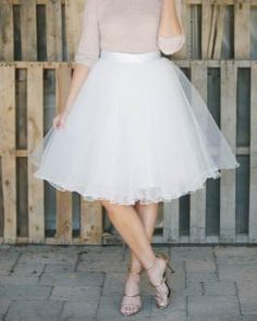 """Meet the perfect tulle skirt! This allure white tulle skirt features 4 layers of tulle, fully lined with a hidden back zipper. This beautiful skirt hits right at the knee, Fit Guide: Size Waist Length Small 25"""" 25"""" Medium 27.5"""" 25"""" Large 29"""" 25"""" Extra Large 30.5"""" 25"""" Details: - 4 tulle layers. - Fully lined. - Hidden back zipper. - Length 25""""."""