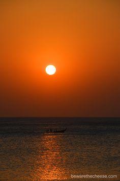 Sunset over a fishing boat in Phuket, Thailand. - www.bewarethecheese.com