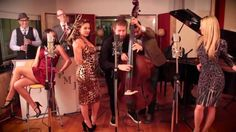 """All About That Bass - Postmodern Jukebox European Tour Version: Recently, American Idol contestant, Joey Cook, performed the PMJ arrangement of """"Fancy"""" by Azelea Banks and it went viral! Check out this PMJ number featuring vocalists Haley Reinhart, Morgan James, and Ariana Savalas rocking some Andrews Sisters- style harmonies, and a sweet four hand bass solo by Casey Abrams and Adam Kubota."""